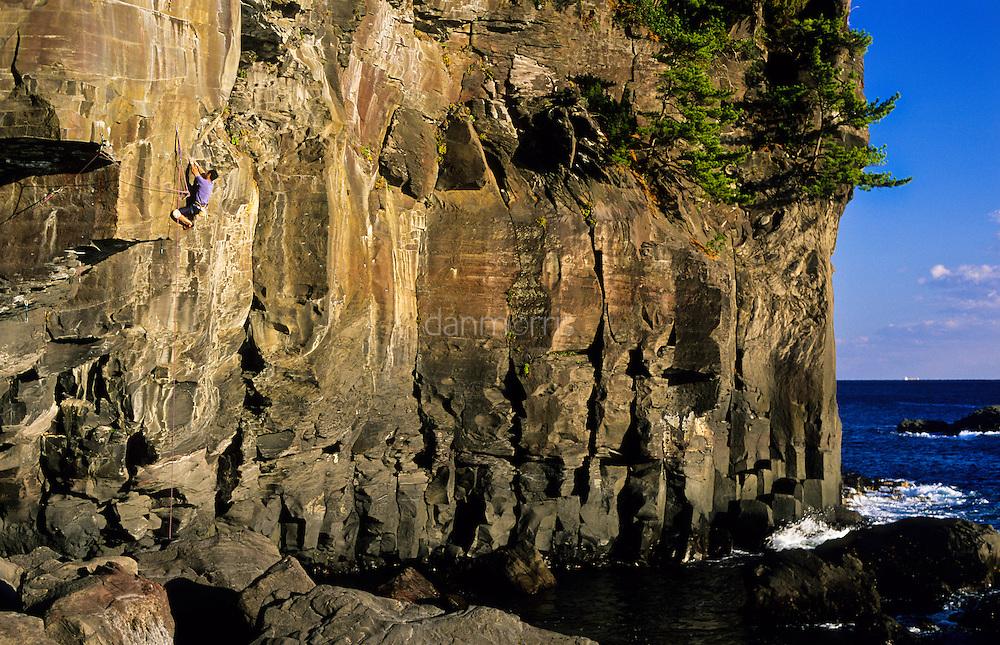 Akihiko Tohara climbing Circus Right, 5.12c/d at sea cliffs of Jogasaki, Japan