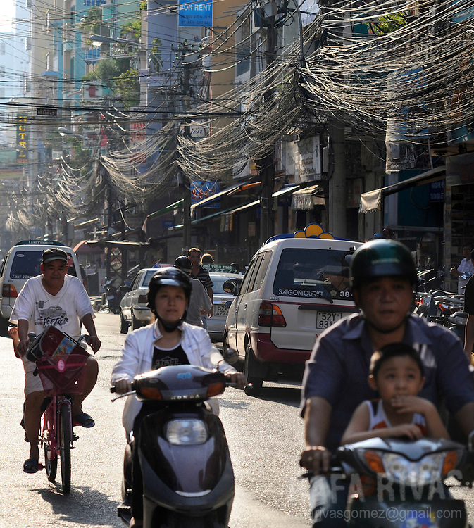 People drive motorcycles in Bui Vien street in Saigon, Vietnam, on January 14, 2009. Photo Rafa Rivas