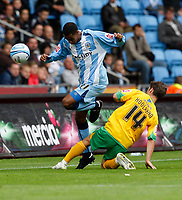 Photo: Richard Lane/Richard Lane Photography. Coventry City v Norwich City. Coca-Cola Championship. 09/08/2008. Coventry's Julian Gray is challenged by Norwich's Wes Hoolahan.