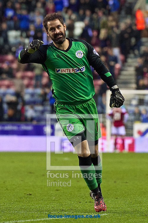 Wigan Athletic goalkeeper Scott Carson celebrates after Shaun Maloney scores their third goal to make it Wigan Athletic 3 Fulham 2 during the Sky Bet Championship match at the DW Stadium, Wigan<br /> Picture by Ian Wadkins/Focus Images Ltd +44 7877 568959<br /> 01/11/2014