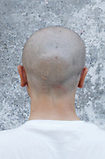 back of man?s head facing a concrete wall