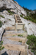 Steps ascend the headwall to reach Three Isle Lake in Peter Lougheed Provincial Park, Kananaskis Country, Alberta, Canada.
