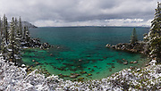 Secret Cove at Lake Tahoe during a clearing snowstorm. This is an ultra high resolution panoramic image