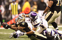 NEW ORLEANS - JANUARY 24: Pierre Thomas #23 of the New Orleans Saints dives for a touchdown against Tyrell Johnson #25 of the Minnesota Vikings at the NFC Championship Game at the Louisiana Superdome on January 24, 2010 in New Orleans, Louisiana. The Saints won 31-28 in overtime to advance to the Super Bowl for the first time. Photo by Tom Hauck.
