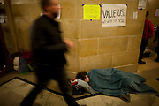A protestor sleeps on the floor of the State Capitol as protests continue in Madison, WI, February 23, 2011.