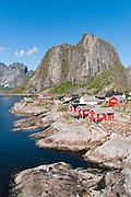 Red rorbus perch on stilts in Hamnøy  fishing village along the shore of Reinefjord, Lofoten archipelago, Nordland county, Norway.