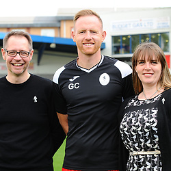 AFC Telford United pre-season photoshoot at the New Bucks Head Stadium on Thursday, August 1, 2019<br /> <br /> Gavin Cowan with sponsors Richard Worton and Katie Peal<br /> <br /> Free for editorial use only<br /> Picture credit: Mike Sheridan/Ultrapress<br /> <br /> MS201920-004