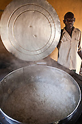 The large pot that is used for cooking for the feeding program at St Patrick's primary school in Thika, Kenya. The kitchen was built by AFCIC (Action for children in conflict) and cooks wages are paid by AFCIC.  75% of the pupils are from the Kiandutu slum and the school run a feeding program helping over 250 children. For some children this in the only meal they will get a day.