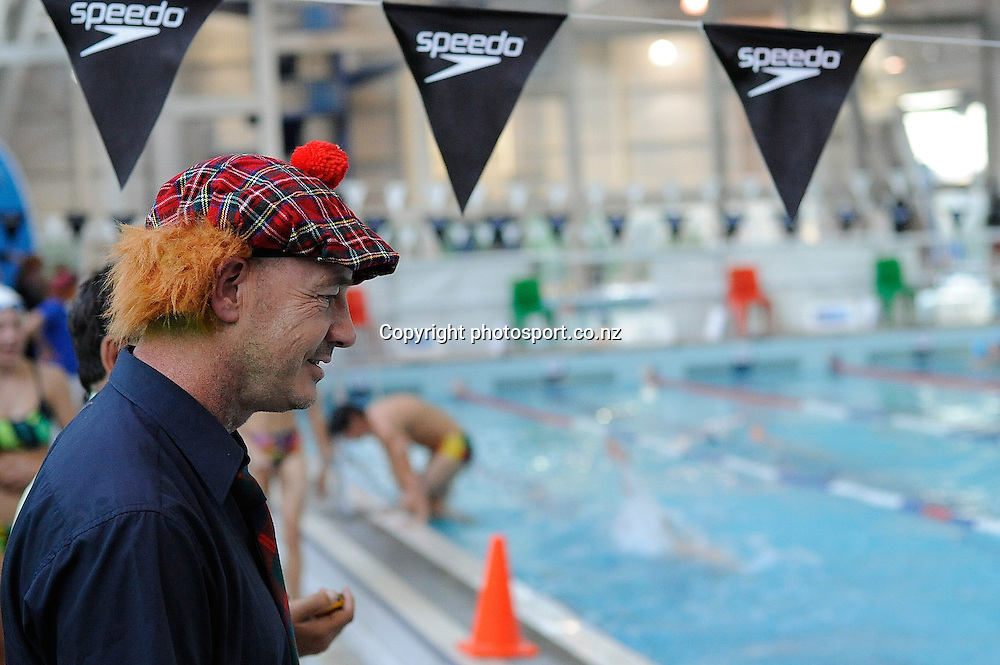 Coach looks on, at the State New Zealand Division II Swimming Champs, at Moana pool, Dunedin, New Zealand. Friday 14 April 2012. Photo: Richard Hood photosport.co.nz