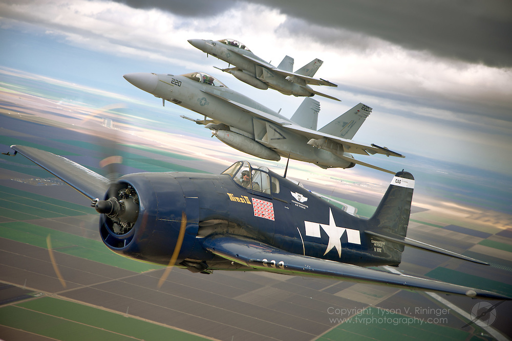 "Capt. Mark ""Mutha"" Hubbard pilots the F-6F Hellcat with Lt. Matt ""11"" Lowe in the F/A-18E and Lt. Erik ""Dookie"" Kenny in the F/A-18F over California's Central Valley during the 2011 USN Tailhook Legacy Flight Qualifications."