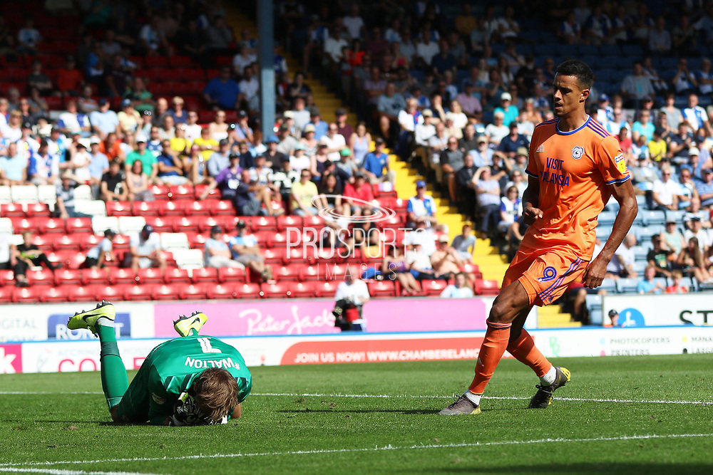 Blackburn Rovers Christian Walton holds on despite Cardiff\s Danny Ward   during the EFL Sky Bet Championship match between Blackburn Rovers and Cardiff City at Ewood Park, Blackburn, England on 24 August 2019.