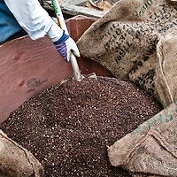 Close up of a pile of finely sifted compost being mixed.