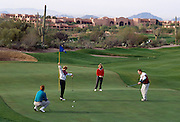 Foursome golfing on fairway, Canyon hole#1, Westin La Paloma. ©1993Edward McCain. All rights reserved. MCain Photography, McCain Creative.