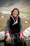 India, Ladakh. Portrait of a nomad woman living in a nomadic camp on the way to Pangong Tso.