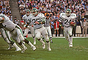 New York Jets running back Mike Augustyniak (35) blocks for Jets running back Freeman McNeil (24) during the NFL football game AFC Divisional Playoff  between the New York Jets and the Los Angeles Raiders in Los Angeles, California on January 15, 1983. The Jets won the game 17-14. ©Paul Anthony Spinelli
