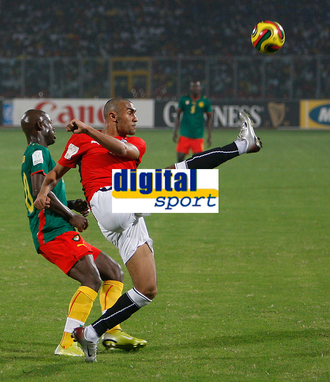 Photo: Steve Bond/Richard Lane Photography.<br />Egypt v Cameroun. Africa Cup of Nations. 22/01/2008. Abdel El Mohamedy (R) clears in front of Achille Emana (L)