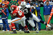 October 11, 2009:   Linebacker Anthony Spencer #93 of the Dallas Cowboys tackles running back Larry Johnson #27 of the Kansas City Chiefs for a loss in the fourth quarter at Arrowhead Stadium in Kansas City, Missouri.  The Cowboys defeated the Chiefs in overtime 26-20...