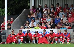 Bristol City players and staff sit on the sideline during their community game against Brislington and Keynsham Town - Photo mandatory by-line: Dougie Allward/JMP - Mobile: 07966 386802 - 05/07/2015 - SPORT - Football - Bristol - Brislington Stadium - Pre-Season Friendly