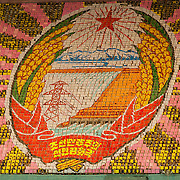 "Arirang Mass Games, Pyongyang, DPRK (North Korea). The text reads ""The People's Democratic Republic of Korea""."