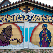 Religious themed murals painted for the local Iowa City Catholic Worker house.<br />