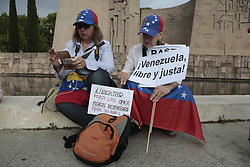 May 1, 2019 - Madrid, Spain - Demonstrators seen with placards during the protest..Hundreds of Venezuelan exiles in Spain are concentrated in the Plaza de Colón in Madrid. They demand the end of the mandate of Nicolas Maduro so that Juan Guaidó can lead the process of free and democratic elections. (Credit Image: © Lito Lizana/SOPA Images via ZUMA Wire)