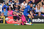 AFC Wimbledon defender Jon Meades (3) battles for possession with Southend United midfielder Will Atkinson (12) during the EFL Sky Bet League 1 match between AFC Wimbledon and Southend United at the Cherry Red Records Stadium, Kingston, England on 25 March 2017. Photo by Matthew Redman.