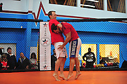 NASCAR driver Kevin Harvick puts MMA fighter Johny Hendricks in a choke hold at Velociti Fitness League in Pantego on Wednesday, April 10, 2013. Hendricks spent the afternoon teaching Harvick a few basic MMA moves. (Cooper Neill/The Dallas Morning News)