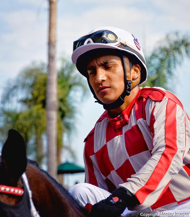 Professional Horse Racing Jockey Rafael Bejarno on mount at Del Mar Racetrack.