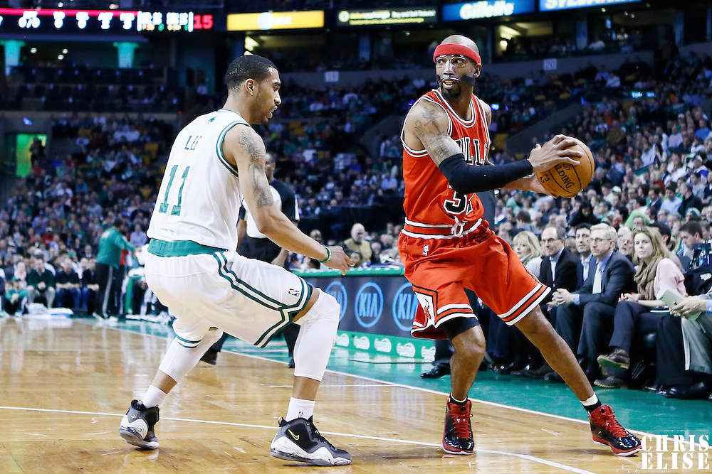 13 February 2013: Boston Celtics shooting guard Courtney Lee (11) defends on Chicago Bulls shooting guard Richard Hamilton (32) during the Boston Celtics 71-69 victory over the Chicago Bulls at the TD Garden, Boston, Massachusetts, USA.