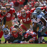 Dallas Cowboys inside linebacker Bradie James (56) and San Francisco 49ers running back Frank Gore (21) during an NFL football game between the Dallas Cowboys and the San Francisco 49ers at Candlestick Park on Sunday, Sept. 18, 2011 in San Francisco, CA.  (Photo/Alex Menendez)