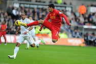 Luis Suarez of Liverpool has a shot at goal. Barclays Premier league, Swansea city v Liverpool at the Liberty Stadium in Swansea , South Wales on Sunday 25th November 2012. pic by Andrew Orchard, Andrew Orchard sports photography,