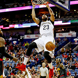 Jan 5, 2017; New Orleans, LA, USA; New Orleans Pelicans forward Anthony Davis (23) dunks past Atlanta Hawks forward Paul Millsap (4) during the first quarter of a game at the Smoothie King Center. Mandatory Credit: Derick E. Hingle-USA TODAY Sports