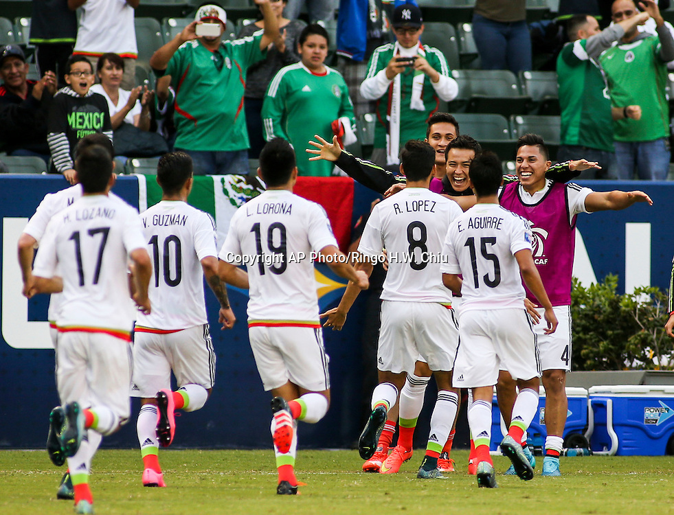 Mexico celebrate their goal in the second half of a CONCACAF men's Olympic qualifying soccer match against Haiti in Carson, Calif., Sunday, Oct. 4, 2015. Mexico won 1-0. (AP Photo/Ringo H.W. Chiu)