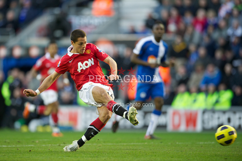 WIGAN, ENGLAND - Saturday, February 26, 2011: Manchester United's Javier Hernandez scores the second goal against Wigan Athletic during the Premiership match at the DW Stadium. (Photo by David Rawcliffe/Propaganda)