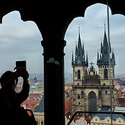 "A tourist takes a ""selfie"" of herself in front of the Church of Our Lady Before Týn from the tower of the Old Town Hall in Prague, Czech Republic on 14 November 2014."