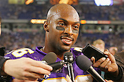 MINNEAPOLIS - NOVEMBER 21:  Cornerback Antoine Winfield #26 of the Minnesota Vikings talks to the media after he intercepted a Joey Harrington pass to ice the game against the Detroit Lions at the Hubert H. Humphrey Metrodome on November 21, 2004 in Minneapolis, Minnesota. The Vikings defeated the Lions 22-19. ©Paul Anthony Spinelli  *** Local Caption *** Antoine Winfield