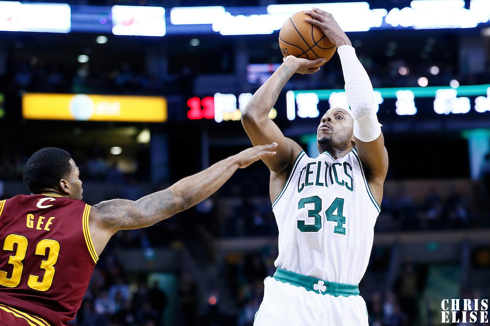 19 December 2012: Boston Celtics small forward Paul Pierce (34) takes a jumpshot over Cleveland Cavaliers small forward Alonzo Gee (33) during the Boston Celtics 103-91 victory over the Cleveland Cavaliers at the TD Garden, Boston, Massachusetts, USA.