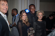 JOCHEN ZEITZ; TARKA RUSSELL; USAIN BOLT; ELIZABETH ESTEVE, Fundraising Gala for the Zeitz foundation and Zoological Society of London hosted by Usain Bolt. . London Zoo. Regent's Park. London. 22 November 2012.