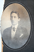 broken and deteriorating oval head and shoulder portrait of a young adult man