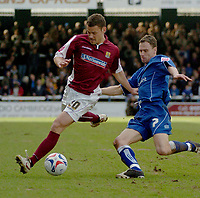 Photo: Ian Hebden.<br /> <br /> Peterborough United v Northampton Town. Coca Cola League 2. 01/04/2006. <br /> <br /> Peterboroughs David Farrell (R) prepares to tackle Northamptons Pedj Bojic (L).