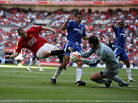 Photo: Rich Eaton.<br /> <br /> Manchester United v Chelsea. FA Community Shield. 05/08/2007. Man United's Wayne Rooney goes in hard on Chelsea goalkeeper Petr Cech and receives a yellow card.