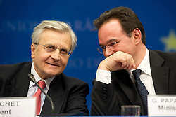 Jean-Claude Trichet, president of the European Central Bank, left, speaks with George Papaconstantinou, Greece's finance minister, during a news conference following an emergency meeting of euro zone finance ministers in Brussels, on Sunday, May 2, 2010. Greece accepted an unprecedented bailout from the European Union and International Monetary Fund worth more than 110 billion euros ($146 billion). (Photo © Jock Fistick)