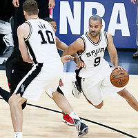 03 May 2017: San Antonio Spurs guard Tony Parker (9) drives past Houston Rockets guard Eric Gordon (10) on a screen set by San Antonio Spurs forward David Lee (10) during the San Antonio Spurs 121-96 victory over the Houston Rockets, in game 2 of the Western Conference Semi Finals, at the AT&T Center, San Antonio, Texas, USA.