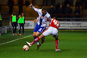 Walsall FC defender Jason Demetriou challenged by Fleetwood Town Midfielder Thomas Grant during the Sky Bet League 1 match between Fleetwood Town and Walsall at the Highbury Stadium, Fleetwood, England on 15 March 2016. Photo by Pete Burns.