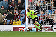 Brighton striker, Bobby Zamora (25) scores the first goal during the Sky Bet Championship match between Burnley and Brighton and Hove Albion at Turf Moor, Burnley, England on 22 November 2015.
