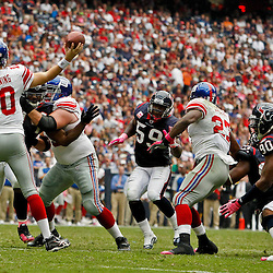 October 10, 2010; Houston, TX USA; New York Giants quarterback Eli Manning (10) is pressured by Houston Texans defensive end Antonio Smith (94) during the first half at Reliant Stadium. Mandatory Credit: Derick E. Hingle