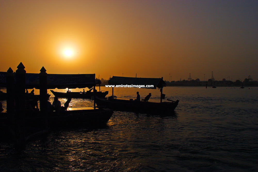 Abras, or water taxis, on the creek in Bur Dubai at sunset.