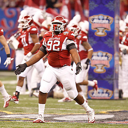 January 4, 2011; New Orleans, LA, USA;  Arkansas Razorbacks defensive tackle DeQuinta Jones (92) runs onto the field prior to kickoff of the 2011 Sugar Bowl against the Ohio State Buckeyes at the Louisiana Superdome.  Mandatory Credit: Derick E. Hingle
