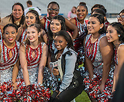 US Olympic gymnast Simone Biles poses for a photograph with Waltrip High School cheerleaders before the Wounded Warrior Amputee Football Team game against NFL Alumni, at Delmar Stadium, February 1, 2017.