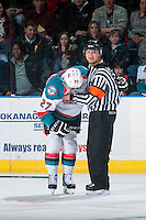 KELOWNA, CANADA - FEBRUARY 28: Referee Chris Crich looks to the bench to call athletic therapist Scott Hoyer to assist after a hit on Josh Morrissey #27 of Kelowna Rockets  on February 28, 2015 at Prospera Place in Kelowna, British Columbia, Canada.  (Photo by Marissa Baecker/Shoot the Breeze)  *** Local Caption *** Chris Crich; Josh Morrissey;